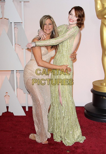 22 February 2015 - Hollywood, California - Emma Stone and Jennifer Aniston. 87th Annual Academy Awards presented by the Academy of Motion Picture Arts and Sciences held at the Dolby Theatre. <br /> CAP/ADM<br /> &copy;AdMedia/Capital Pictures Oscars