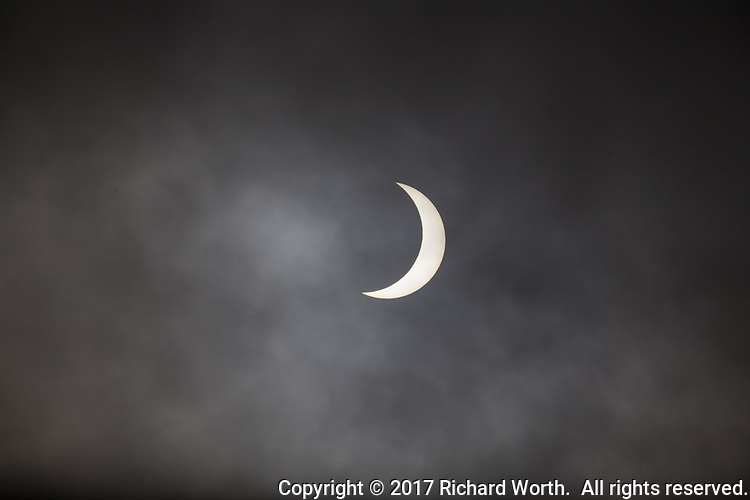 Within two minutes of maximum, the moon covered 75% of the sun's surface as seen through the clouds from San Leandro, California, August 21, 2017.