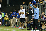 19 September 2014: Duke head coach John Kerr (center) watches his counterpart, UNC head coach Carlos Somoano (right). The Duke University Blue Devils hosted the University of North Carolina Tar Heels at Koskinen Stadium in Durham, North Carolina in a 2014 NCAA Division I Men's Soccer match. Duke won the game 2-1.