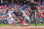 20 September 2015: Washington Nationals outfielder Bryce Harper is called safe on a home plate collision with Miami Marlins catcher Tomas Telis on a Jayson Werth double in the first inning at Nationals Park in Washington, DC. The Nationals defeated the Marlins 13-3 to take the final game of their 4-game series. Mandatory Credit: Ed Wolfstein Photo *** RAW (NEF) Image File Available ***