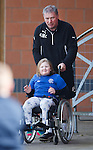 Ally McCoist with fan Abigail Webster, 7 from Paisley as supporters group Sons of Struth take a party of disabled kids on a tour of the training ground this morning