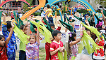 """Students from all grades perform the popular """"Little Grass"""" dance at the Dragon and Phoenix Spark Park dedication ceremony at Mandarin Immersion Magnet School on Oct. 27, 2017."""