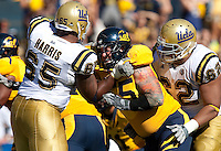 Michael Costanzo (right) battles against Mike Harris (left). The California Golden Bears defeated the UCLA Bruins 35-7 at Memorial Stadium in Berkeley, California on October 9th, 2010.