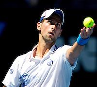 NOVAK DJOKOVIC (SRB) against SANTIAGO GIRALDO (COL) in the second round of the Men's Singles. Novak Djokovic beat Santiago Giraldo 6-3 6-2 6-1..19/01/2012, 19th January 2012, 19.01.2012..The Australian Open, Melbourne Park, Melbourne,Victoria, Australia.@AMN IMAGES, Frey, Advantage Media Network, 30, Cleveland Street, London, W1T 4JD .Tel - +44 208 947 0100..email - mfrey@advantagemedianet.com..www.amnimages.photoshelter.com.