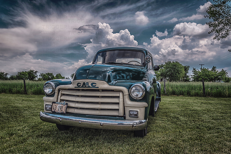 Classic Vintage truck in USA made by GMC outdoors under a stormy sky