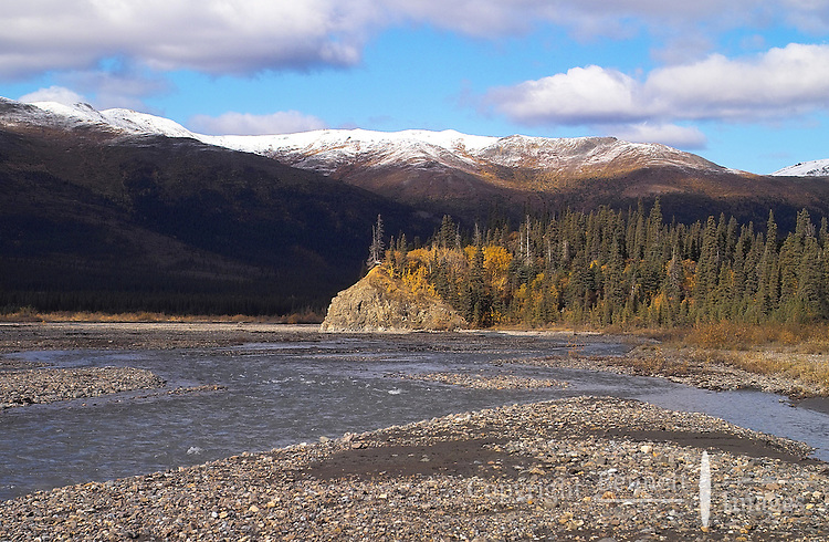 The Teklanika River is highlighted by a ray of sunshine at Denali National Park.