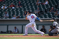 Mesa Solar Sox second baseman David Bote (15), of the Chicago Cubs organization, follows through on his swing during a game against the Salt River Rafters on October 18, 2017 at Sloan Park in Mesa, Arizona. The Rafters defeated the Solar Sox 6-5.(Zachary Lucy/Four Seam Images)