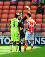 Blackpool's Danny Pugh is shown a yellow card by Referee John Brooks<br /> <br /> Photographer Kevin Barnes/CameraSport<br /> <br /> Football - The EFL Sky Bet League Two - Blackpool v Exeter City - Saturday 6th August 2016 - Bloomfield Road - Blackpool<br /> <br /> World Copyright &copy; 2016 CameraSport. All rights reserved. 43 Linden Ave. Countesthorpe. Leicester. England. LE8 5PG - Tel: +44 (0) 116 277 4147 - admin@camerasport.com - www.camerasport.com