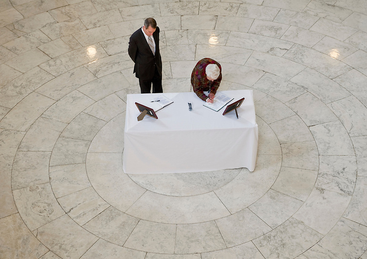 WASHINGTON, DC- Jan. 11: In the Cannon House Office Building rotunda, people sign books of well wishes and condolences for victims of the shooting in Tuscon, Ariz., on Jan. 8 that killed six and injured 14, including Rep. Gabrielle Giffords, D-Ariz., who is recovering after being shot in the head. (Photo by Scott J. Ferrell/Congressional Quarterly)