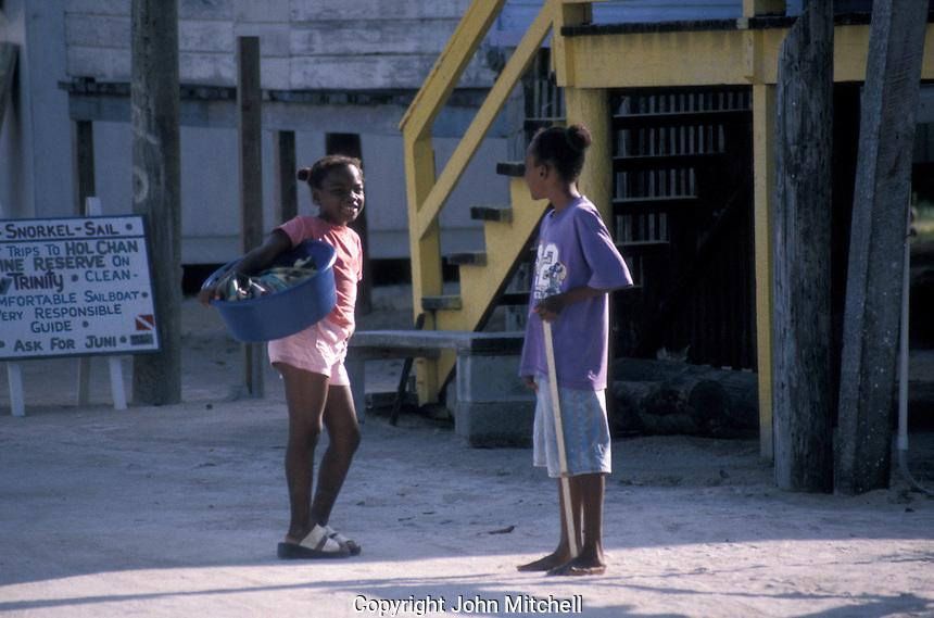 Young black children chatting on Caye Caulker, Belize