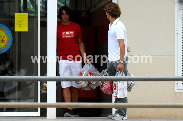 **ALL ROUND PICTURES FROM SOLARPIX.COM**.**WORDLWIDE SYNDICATION RIGHTS EXCEPT FOR SPAIN**NO PUBLICATION IN SPAIN**.Spanish tennis ace Fafeal Nadal is spotted by a young fan as he emerges from a supermarket with a mate after doing a spot of food shopping in Mallorca..JOB REF: 7469       PTB        DATE:  25.09.08.**MUST CREDIT SOLARPIX.COM OR DOUBLE FEE WILL BE CHARGED* *UNDER NO CIRCUMSTANCES IS THIS IMAGE TO BE REPRODUCED FOR ANY ONLINE EDITION WITHOUT PRIOR PERMISSION*
