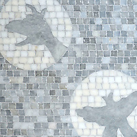 Creatures of the Night, a hand-cut and waterjet stone mosaic, shown in honed Allure and Afyon White, is part of the Kiddo Collection by Cean Irminger for New Ravenna.