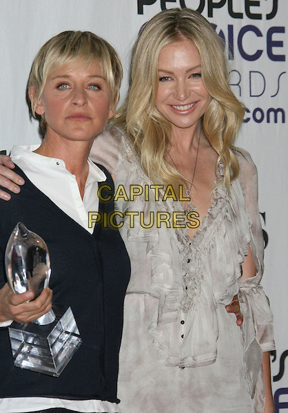 ELLEN DEGENERES & PORTIA DE ROSSI.Pressroom at the 35th Annual People's Choice Awards held at The Shrine Auditorium, Los Angeles, California, USA..January 7th, 2009 .press room half length black cardigan award trophy white grey gray dress couple .CAP/ADM/MJ.©Michael Jade/AdMedia/Capital Pictures.
