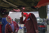 Two instructors using an inspection lamp, Motor Mechanics, Further Education College.
