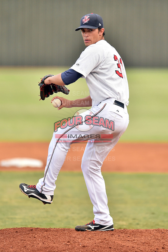 Elizabethton Twins starting pitcher Derek Rodriguez (12) warms up between innings during a game against the Bristol Pirates on September 1, 2015 in Elizabethton, Tennessee. The Twins defeated the Pirates Gnats 6-1. (Tony Farlow/Four Seam Images)