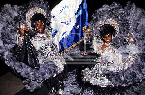 Rio de Janeiro, Brazil. Smiling man and woman in blue grey feather and sequin carnival costumes - Standard bearers, Tradicao.