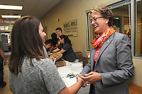 NWA Democrat-Gazette/FLIP PUTTHOFF <br /> PIZZA CHAT<br /> Caitlyn Seoane (cq) (left) talks with Evelyn Jorgenson, president of Northwest Arkansas Community College, during a pizza lunch Wednesday Sept. 30 2015 at NWACC. Jorgenson greeted and chatted with students who filed into Success Hallway at Burns Hall for pizza and soft drinks. Students from the NWACC Student Ambassador and Activities Board served the lunch. Students could also complete a short survey about their satisfaction with the NWACC college experience.