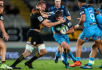 Piers Francis of the Blues tries to hand off Dominic Bird during the Super Rugby Match between the Blues and the Chiefs at Eden Park in Auckland, New Zealand on Friday, 26 May 2017. Photo: Simon Watts / www.lintottphoto.co.nz