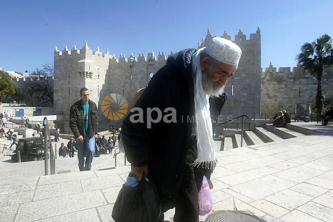 Palestinians walk outside Damascus Gate leading into the old city of Jerusalem on March 6, 2012. Photo by Mahfouz Abu Turk