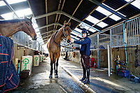 Pictured: Sean Bowen with a horse in the barn. Wednesday 10 January 2018<br /> Re: Peter Bower Racing in Little Newcastle, west Wales, UK.