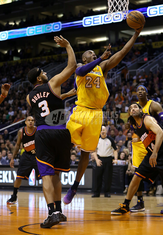 Jan. 30, 2013; Phoenix, AZ, USA: Los Angeles Lakers guard Kobe Bryant (24) drives to the basket past Phoenix Suns forward Jared Dudley at the US Airways Center. Mandatory Credit: Mark J. Rebilas-
