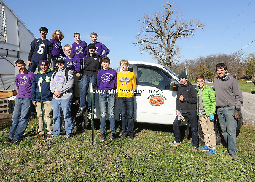 Students in Zach Haselhorst's Kairos group pose for a picture after working at Teter Organic Farm in Noblesville.