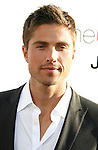 """HOLLYWOOD, CA. - July 16: Eric Winter  arrives at the Los Angeles premiere of """"The Ugly Truth"""" held at the Pacific's Cinerama Dome on July 16, 2009 in Hollywood, California."""