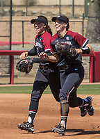 NWA Democrat-Gazette/BEN GOFF @NWABENGOFF<br /> Kenzi Maguire (left), South Carolina shortstop, and Mackenzie Boesel, South Carolina second baseman, run in after a double play to end the 1st inning vs Arkansas Sunday, March 17, 2019, at Bogle Park in Fayetteville.