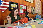 Old Bethpage, New York, U.S. 29th September 2013.  L-R, LAURA BORLEY, of Jericho, CAROL IRWIN, of Levittown, and MARIE MARTIN, of Freeport, members of the Long Island Quliters' Society, are quilting in the Exhibition Hall at The Long Island Fair. A yearly event since 1842, the county fair is now held at a reconstructed fairground at Old Bethpage Village Restoration.