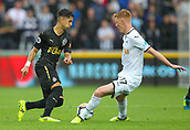 10th September 2017, Liberty Stadium, Swansea, Wales; EPL Premier League football, Swansea versus Newcastle United; Ayoze Perez of Newcastle United takes on Sam Clucas of Swansea City