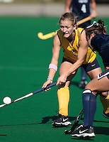 Stephanie Hoyer (#20 University of Michigan)hits the ball around a Penn State Player at the 2007 Big Ten Field Hockey Championships held at The Ohio State University on November 2nd, 2007.