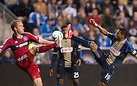 Jeff Larentowicz (20) of the Chicago Fire fights for the ball with Kleberson (19) of the Philadelphia Union during a Major League Soccer match at PPL Park in Chester, PA.  Philadelphia defeated Chicago, 1-0.