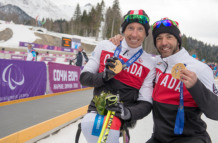 Sochi, RUSSIA - Mar 16 2014 - Chris Klebl with his Men's 10km Sitting gold medal and Brian McKeever with his 15km free Visually Imaired gold medal at the 2014 Paralympic Winter Games in Sochi, Russia.  (Photo: Matthew Murnaghan/Canadian Paralympic Committee)