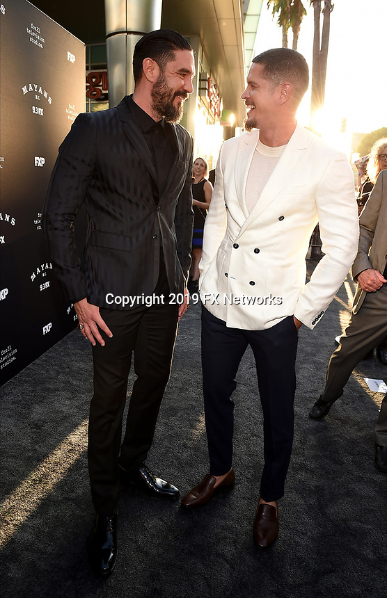 """LOS ANGELES - AUGUST 27: Clayton Cardenas (L) and JD Pardo attend the season two red carpet premiere of FX's """"Mayans M.C"""" at the ArcLight Dome on August 27, 2019 in Los Angeles, California. (Photo by Frank Micelotta/FX/PictureGroup)"""