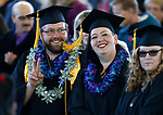 Graduates Ben McCulley and Megan Walsh wave to supporters during at the 2019 commencement for Western Nevada College, in Carson City, Nev., on Monday, May 20, 2019. <br /> Photo by Cathleen Allison/Nevada Momentum