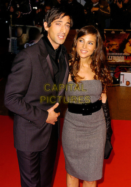 "ADRIEN BRODY & ELSA PATAKY.At The Times BFI London Film Festival Gala Screening of ""Hollywoodland"", held at Odeon West End, London, England, October 30th 2006..half length red carpet grey dress black belt.Ref: CAN.www.capitalpictures.com.sales@capitalpictures.com.©Can Nguyen/Capital Pictures"