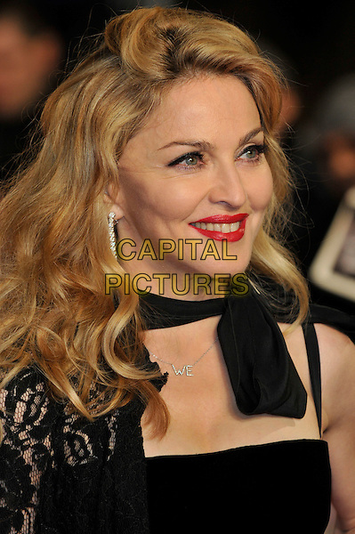 Madonna.W.E. Uk film premiere at Odeon cinema, Kensington, London, England..11th January 2011.headshot portrait black lace bow red lipstick  .CAP/PL.©Phil Loftus/Capital Pictures.