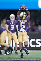 Chico McClatcher hauls in a pass from Jake Browning.