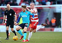 Conor McAleny of Fleetwood Town wins the ball against Luke McCullough of Doncaster Rovers during the Sky Bet League 1 match between Doncaster Rovers and Fleetwood Town at the Keepmoat Stadium, Doncaster, England on 17 February 2018. Photo by Leila Coker / PRiME Media Images.
