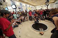 Standard Sumo. RobotChallenge 2010. First European Robot Sumo Championship..Two robots compete and try to push the competitor off the ring. There are different classes: Standard (3kg), Mini (500g), Micro (100g), Nano (25g) and Humanoid Sumo.