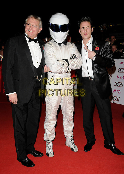 GRAHAM COLE, GUEST & GARY LUCY.Arriving at the National Television Awards held at the Royal Albert Hall, London, England..October 29th, 2008 .NTA red carpet arrivals full length black suit tuxedo white suit helmet arms crossed costume .CAP/CAN.©Can Nguyen/Capital Pictures.
