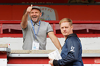 (L-R) Former Swansea player Andy Robinson gives the thumbs up while speaking to Alan Tate of Swansea prior to the Sky Bet Championship match between Barnsley and Swansea City at Oakwell Stadium, Barnsley, England, UK. Saturday 19 October 2019