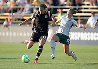 Christine Sinclair (left) passes the ball down the field, defended by Elise Weber (right). FC Gold Pride tied the St. Louis Athletica 1-1 at Buck Shaw Stadium in Santa Clara, California on August 9, 2009.