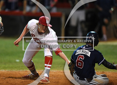 Lake Mary Rams pitcher Nikolas Kovach (12) attempts to tag Jay Charleston (6) scoring a run on a passed ball during a game against the Lake Brantley Patriots on April 2, 2015 at Allen Tuttle Field in Lake Mary, Florida.  Lake Brantley defeated Lake Mary 10-5.  (Mike Janes Photography)