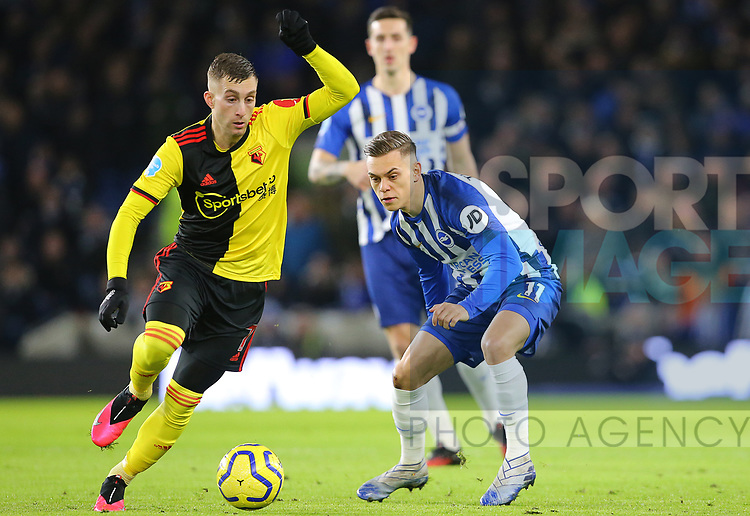Brighton's Leandro Trossard and Watford's Gerard Deulofeu challenge for the ball during the Premier League match at the American Express Community Stadium, Brighton and Hove. Picture date: 8th February 2020. Picture credit should read: Paul Terry/Sportimage