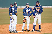 Griffin Wise #22, Brett Underwood #1, Craige Lyerly #16 and Brett Huffman #41 of the Catawba Indians huddle during a pitching change on February 14, 2010 in Salisbury, North Carolina.  Photo by Brian Westerholt / Four Seam Images