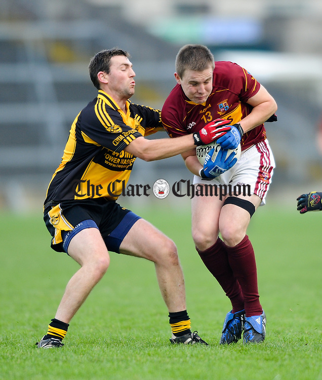 Seanie Malone of Miltown in action against Gavin Carey of Clyda Rovers during their Intermediate Club Munster Final at The Gaelic Grounds. Photograph by John Kelly.