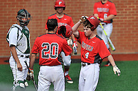 Third baseman Tom Ryan (4) of the Fairfield Stags is congratulated by Mitch Williams after hitting a home run in a game against the Charlotte 49ers on Saturday, March 12, 2016, at Hayes Stadium in Charlotte, North Carolina. (Tom Priddy/Four Seam Images)