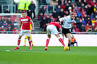 Oli McBurnie of Swansea City battles with Marlon Pack of Bristol City during the Sky Bet Championship match between Bristol City and Swansea City at Ashton Gate in Bristol, England, UK. Monday 02 February 2019