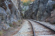 Crawford Notch State Park - Crawford Notch Pass along the Maine Central Railroad in the White Mountains, New Hampshire USA. Chartered in 1867 as the Portland & Ogdensburg Railroad Company then leased to the Maine Central Railroad in 1888 and later abandoned in 1983. Since 1995 the Conway Scenic Railroad, which provides passenger excursion trains has been using the track